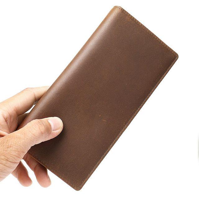 Bề mặt trơn đẹp mắt của ví cầm tay nam da bò D097